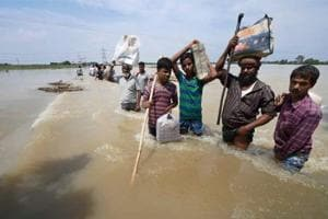Purnea: Flood-affected villagers shift with their belongings in Purnea district on Tuesday.