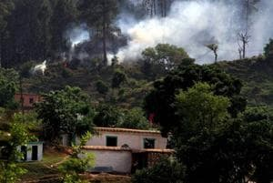 Smoke billows out after a mortar shell was allegedly fired by the Pakistani Army along the Line of Control in Rajouri district.