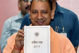 Uttar Pradesh Chief Minister Yogi Adityanath releasing