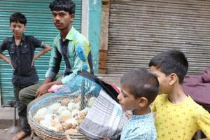 Raj Kumar sells chicks in Shahdara.