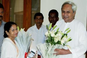 Odisha chief Minister Naveen Patnaik greets his West Bengal counterpart Mamata Banerjee at his residence in Bhubaneswar.  The popularity of powerful regional leaders like Mamata Banerjee and Naveen Patnaik shows no signs of waning dramatically even if fraying at the edges
