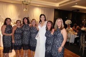 Six women turn up at a wedding in the same dress and no, they aren't...
