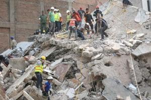 'I pray she's already dead': Chaos as Mexico City block collapses...