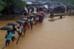 Myanmar leader Suu Kyi explains why she didn't name Rohingya in state...