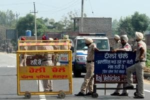 Punjab police personnel stand guard at a nakka in Sangrur on Thursday ahead of the five-day protest from Friday against the state government for not fulfilling promises mentioned in the election manifesto.