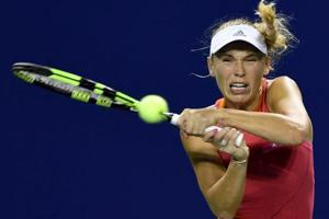 Caroline Wozniacki keeps Pan Pacific Open title defence alive,...