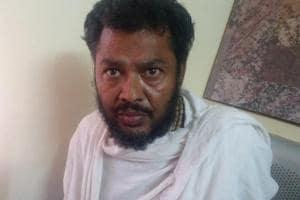 Godman Mohan Govind Das in police custody at Mathura.