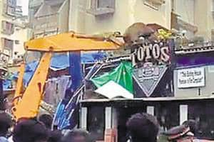 Mumbai civic body razes illegal extension of iconic Toto's Garage and...