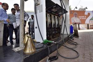 Authorities check a fuel station. Petroleum minister Dharmendra Pradhan has suggested that petroleum products be brought under GST for uniform tax mechanism across India.
