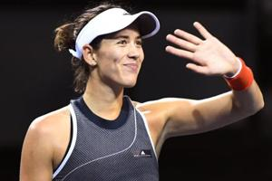 Garbine Muguruza of Spain celebrates her win over Caroline Garcia of France at the Pan Pacific Open tennis tournament.