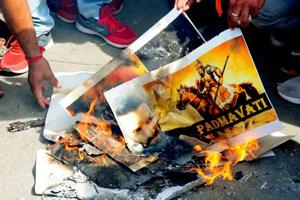 Karni Sena members burn posters of Padmavati in Jaipur, say won't let...
