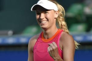 Caroline Wozniacki batters Garbine Muguruza to reach Tokyo tennis...