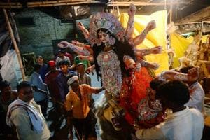A finished clay idol of the Hindu Goddess Durga is transported to worship place from a workshop in Allahabad.