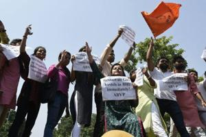 Students of ABVP protest against violence at BHU, near Shastri Bhawan on Monday.