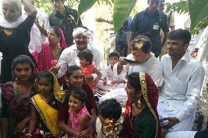Rahul Gandhi sips tea with an Ahir family at Hanjrapar village on Monday during the first day of his Navsarjan Yatra. (HT Photo)