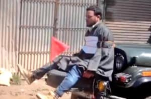 Screengrab of a video showing Farooq Ahmed Dar tied to a jeep as a 'human shield' against protesters.The video had triggered outrage in Kashmir.