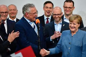 German elections: Merkel wins fourth term but country sees surge in...