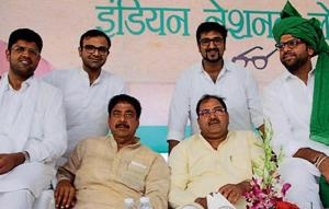 INLD leaders Ajay Chautala and Abhay Chautala, (sitting in the middle), MPDushyant Chautala (left) and INSOpresident Digvijay Singh Chautala (right)at a rally in Bhiwani on Monday.