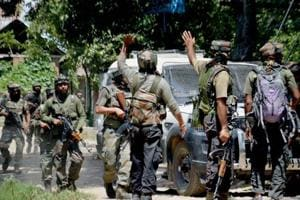 Army in action outside a house where militants were hiding during an encounter in which top three Hizbul Mujahideen commanders were killed, at Awneera in Shopian district of south Kashmir on August 13.