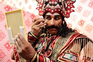 Actor Mukesh Rishi puts on makeup before going on stage at the Luv Kush Ramlila in the Capital.