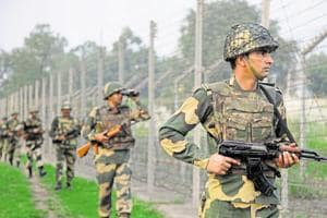 Border Security Force soldiers patrol the India-Pakistan border.