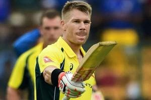 David Warner slammed a century to guide Australia to victory over India in the 4th ODIencounter in Bangalore. Get highlights of India vs Australia, 4th ODI in Bangalore, here