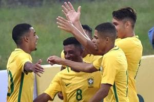 Brazil U-17 football team players celebrate after scoring against New Zealand U-17 football team during a practice match ahead of the FIFA U-17 World Cup in Mumbai