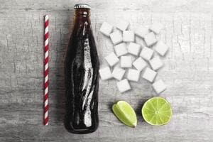 A large fountain Coke or Pepsi of the sort they have in cinema halls, can contain upto 27 spoons of sugar