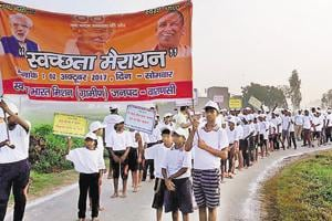 People take out a Swachhata Marathon in Kashi on Monday.