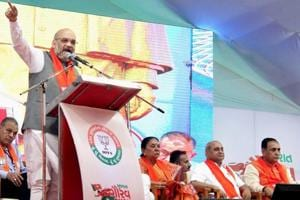 BJP president Amit Shah addresses a function to kick off the Gujarat Gaurav Yatra for the forthcoming assembly polls in Anand on Sunday.