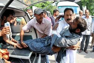 An injured being shifted to a government medical college for a treatment in Jammu on Monday. Two children were killed and 12 villagers injured as Pakistan targeted Indian villages and posts with heavy gunfire and mortar shells along the line of control (LoC) in Jammu and Kashmir's Poonch district on Monday.