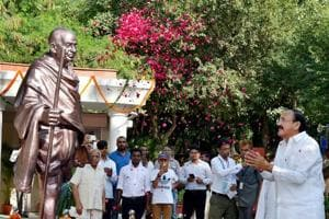 Vice President M. Venkaiah Naidu unveils a statue of Mahatma Gandhi on his 148th birth anniversary, at Rajghat Samadhi Complex, in New Delhi on Monday.
