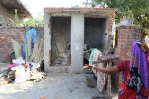 Firewood and other household goods are piled in  a toilet and a bathroom at a  house in a village in the outskirts of Jaipur. The house owner cited financial constraints in setting up  a water tank and constructing the cess pit.