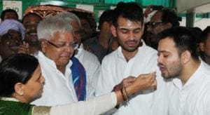 RJD chief Lalu Prasad and his wife Rabri Devi with their sons Tej Pratap Yadav and Tejashwi Prasad Yadav.