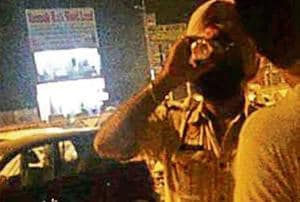 A video grab showing a constable consuming liquor near a petrol pump in Amritsar on Monday.
