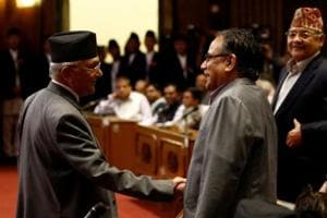 """File photo of Nepal's former premier KP Oli shaking hands with CPN-Maoist Centre leader Pushpa Kamal Dahal """"Prachanda"""" (right) after announcing his resignation in parliament in July 2016."""