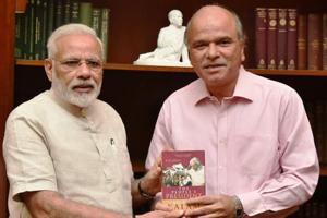 Author SM Khan with Prime Minister Narendra Modi.