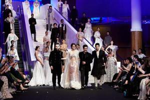 Actor Kriti Sanon, filmmaker Karan Johar and actor Sidharth Malhotra walked for Manish Malhotra  at Design One, Dubai