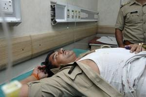 Sub-inspector Satish Kumar, admitted at Kailash hospital, after he received a bullet injury in the alleged encounter.