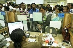 People deposit discontinued notes at a bank in Guwahati on December 30, 2016. India pulled out old Rs 500 and Rs 1,000 notes from circulation in November last year.