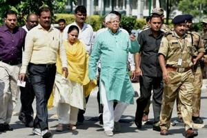 RJD leader and former railway minister Lalu Prasad, accompanied by his daughter Misa, arrives at the CBI headquarters in New Delhi on Thursday for questioning.