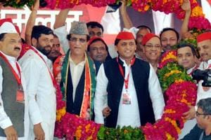 Samajwadi Party President Akhilesh Yadav, accompanied by Mohd Azam Khan and other leaders, being garlanded during the party