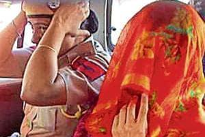 Honeypreet Insan (face covered) in a police car in Bathinda on Thursday.