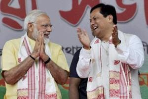 Prime Minister Narendra Modi with Assam chief minister Sarbananda Sonowal during a public rally organised to celebrate the third anniversary of the NDA government at the Centre, in Guwahati on Friday.