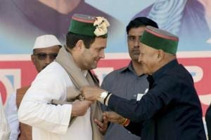 Himachal Pradesh CM Virbhadra Singh (right) welcomes Rahul Gandhi during a rally in Mandi on Saturday.