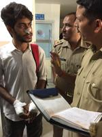 Jayesh, one of the accident survivors, speaks with the police after being discharged from the hospital on Sunday.