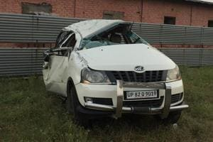 The car collided with the road divider and toppled thrice, throwing most of the passengers out through the windows.