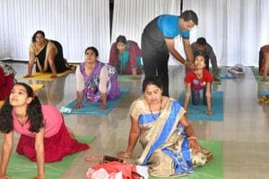 Yoga trainer Rajesh Kumawat giving yoga tips to the patients at ESIC hospital in Jaipur.
