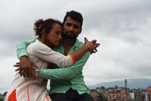 This photo taken on August 3, 2017 shows Nepali transgender person Monika Shahi Nath and her husband Ramesh Nath Yogi in Kathmandu. The couple have found a rare acceptance in Nepal, where many transgenders still struggle to be open about their identity.