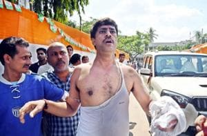 A Cong worker in torn clothes after fisticuffs broke out during a meeting at party office in Patna on Monday.